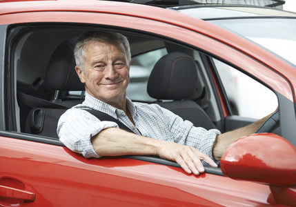 43055781 - portrait of senior man driving car