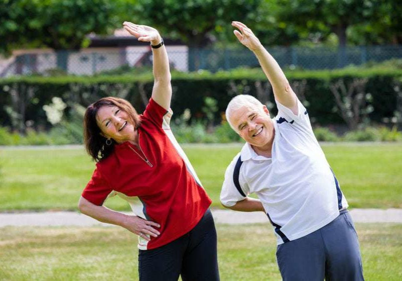 64951122 - active senior couple doing work out in park at morning